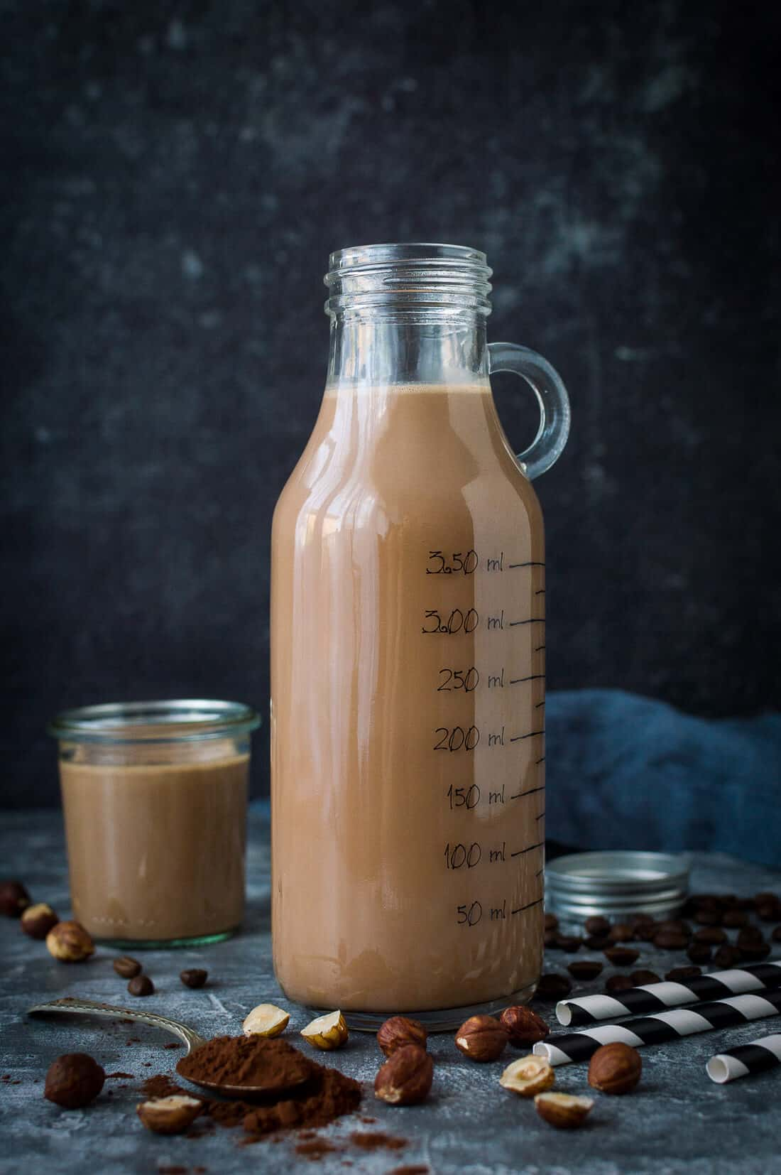 A bottle of mocha hazelnut milk - from scratch chocolate and coffee toasted hazelnut milk. Vegan/refined sugar free