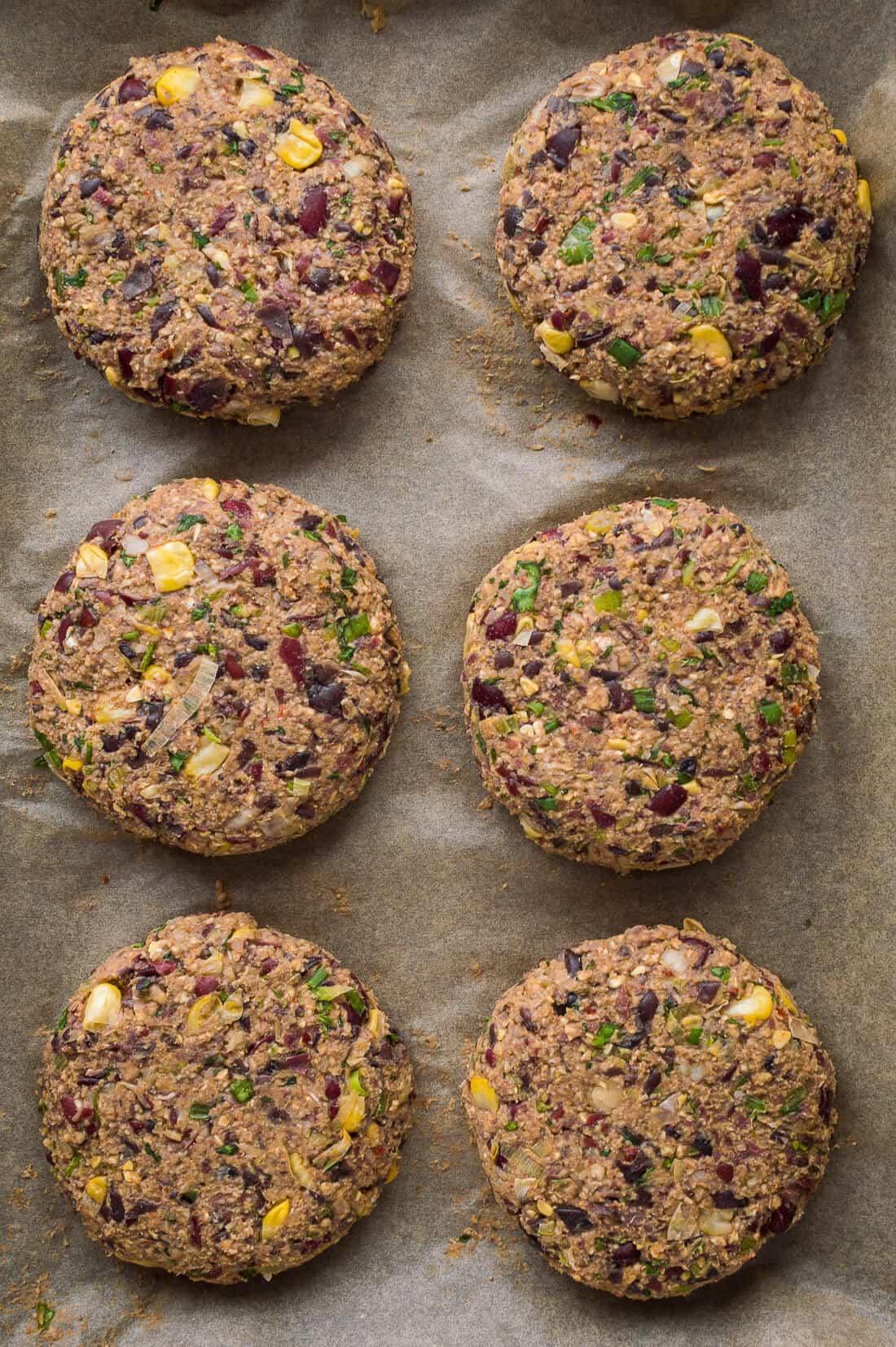 Uncooked vegan mexican black and kidney bean burger patties