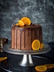 Orange and almond cake with chocolate buttercream - three layers of moist, flavourful vegan orange and almond cake with vegan chocolate orange buttercream, chocolate drip and candied orange slices. Easy to make and perfect for celebrations!