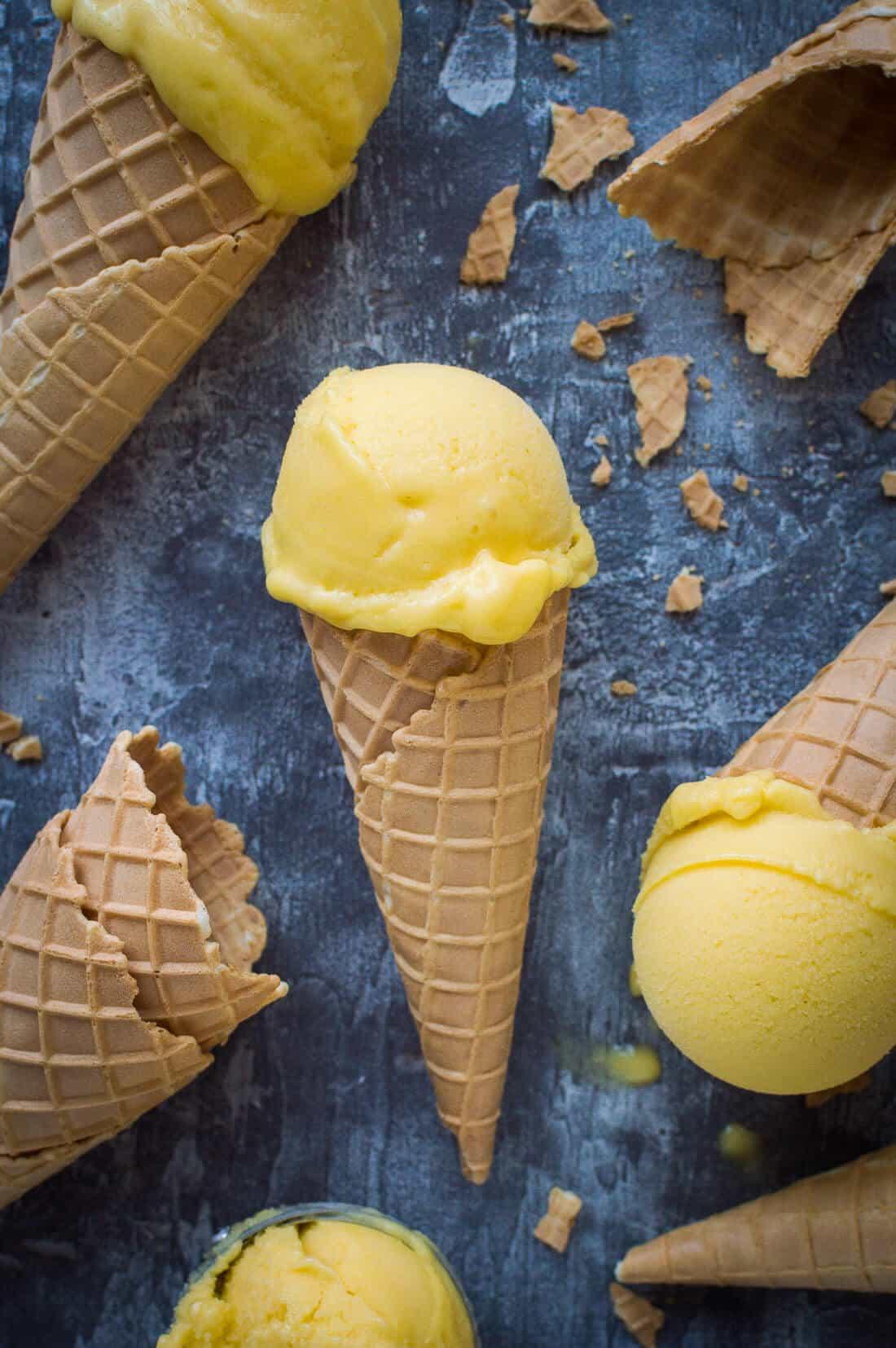 Vegan mango lassi sorbet cones - made with fresh mango, coconut yogurt and lime.