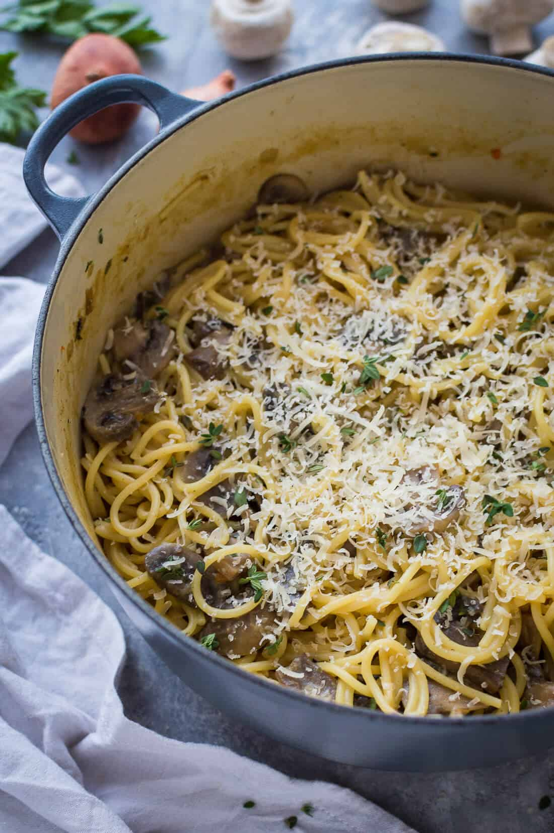 one pot mushroom pasta in a grey pan topped with vegan parmesan
