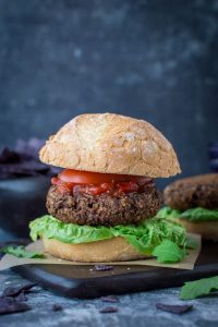 Mushroom lentil burgers - savoury, umami flavoured vegan veggie burgers made with mushrooms, puy lentils and walnuts. Packed with veggies and protein these burgers make a delicious healthier option that will satisfy even the meat eaters. #vegan #burger #veggieburger #mushroomburger