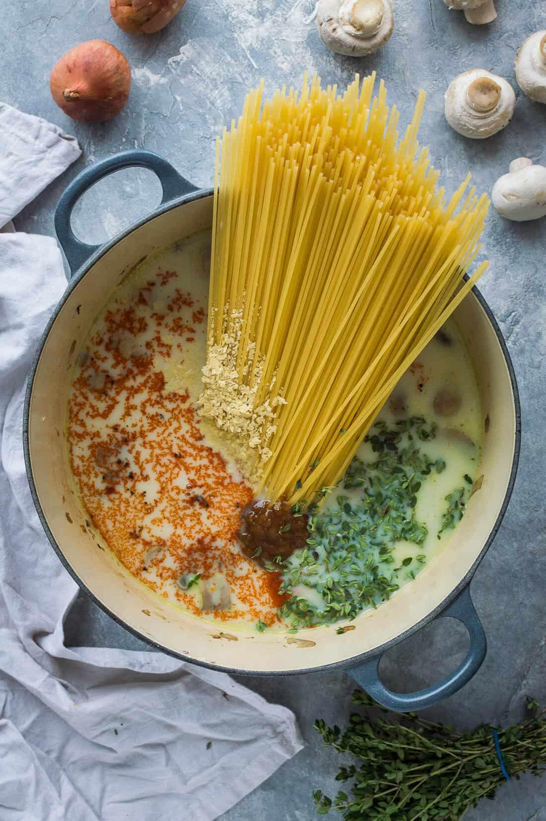 Vegan one pot mushroom pasta ingredients in a pot