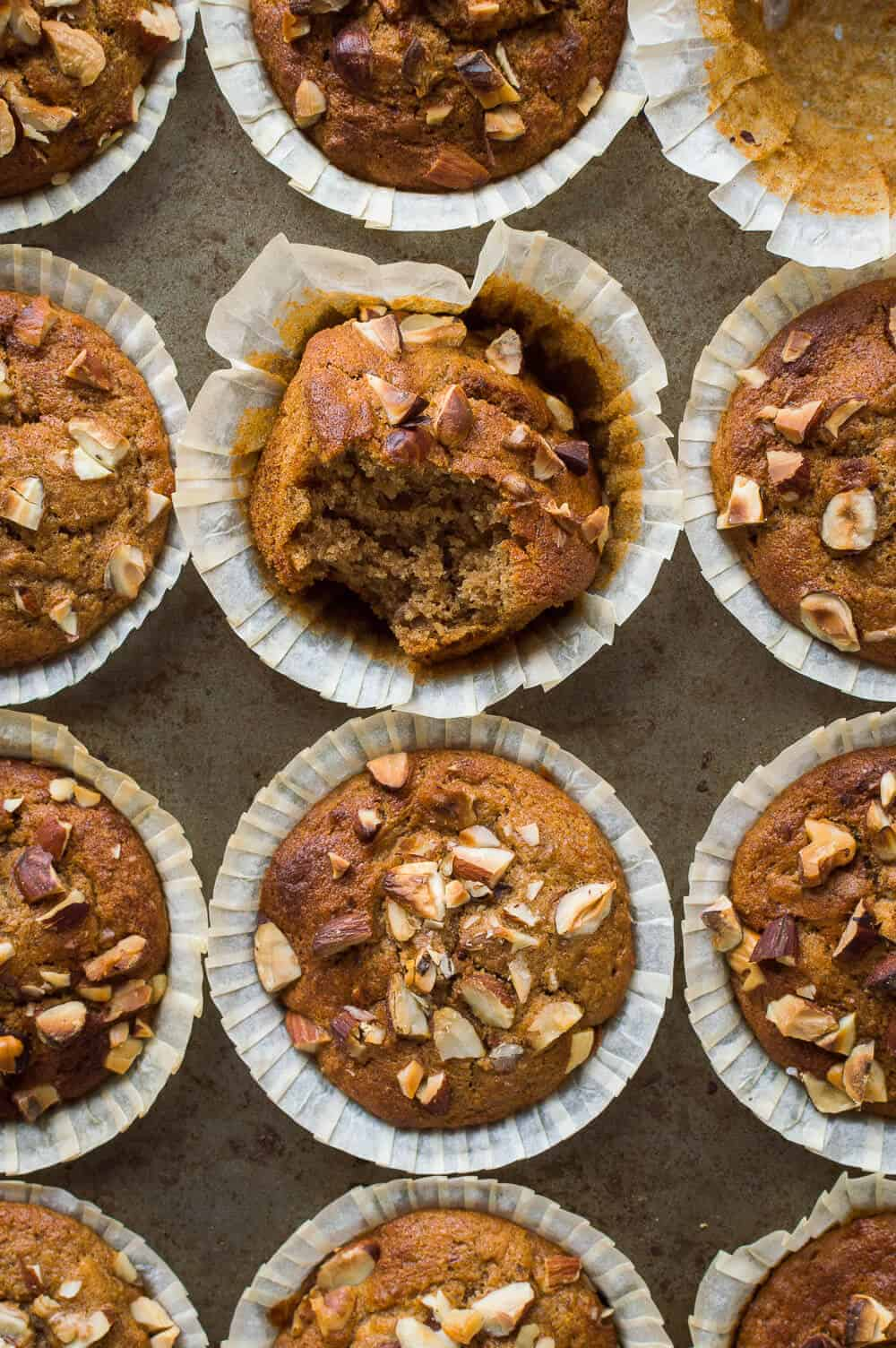Banana nut muffins - moist, flavourful, quick and easy to make vegan banana muffins filled with chopped mixed nuts. Perfect for breakfast or snacking. #vegan #veganbaking #muffins #breakfast #snack