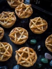 Pentagram topped vegan apple pies for Halloween - these mini vegan apple pies are topped with a pastry pentagram; perfect for Halloween and fans of Supernatural! Step by step instructions included. #vegan #Halloween #applepie