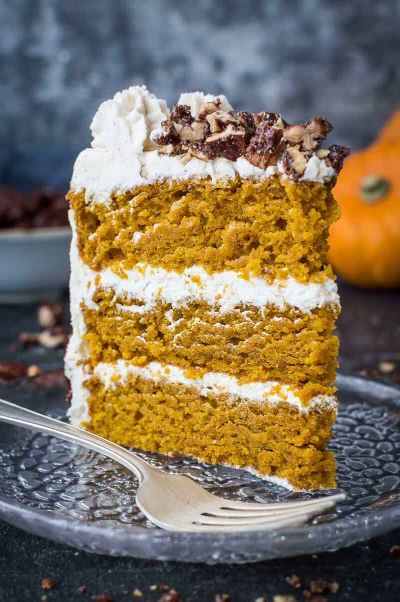 Vegan pumpkin cake with maple pecans and cinnamon buttercream - this easy to make, fluffy, moist and perfectly spiced cake is perfect for Autumn; you would never guess that it's vegan! #vegan #pumpkinspice #layercake #pumpkin