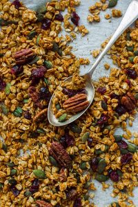 Pumpkin spice granola - this easy to make vegan granola is crunchy, flavourful and utterly addictive! Perfect for breakfast with milk or yogurt, or just for eating by the handful as a snack. #granola #vegan #plantbased #breakfast #snack #pumpkinspice