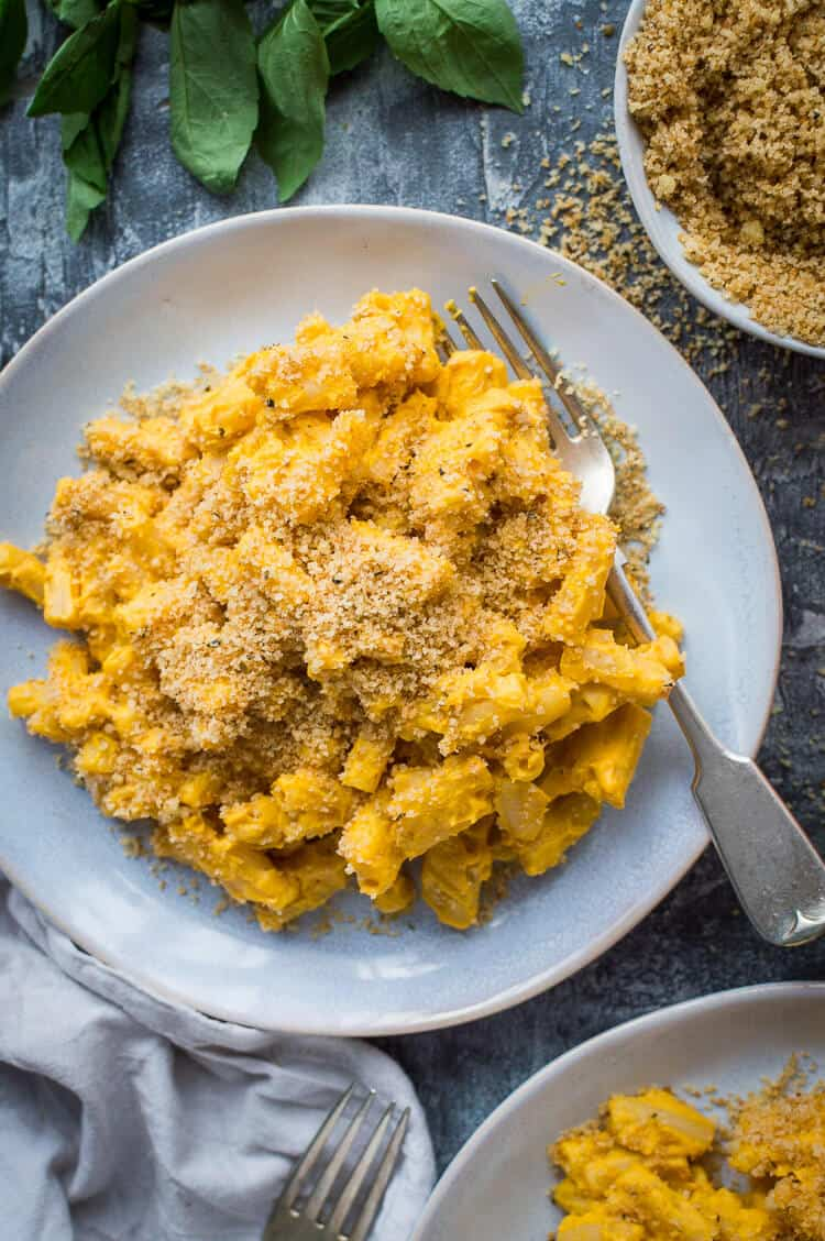 Close up of a plate of vegan pumpkin mac and cheese with garlic breadcrumbs.