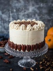 Vegan pumpkin cake with maple pecans and cinnamon buttercream - this easy to make, fluffy, moist and perfectly spiced cake is perfect for Autumn; you would never guess that it's vegan! #vegan #pumpkinspice #layercake