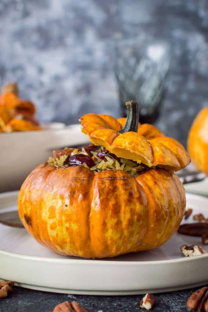 Stuffed mini pumpkins with cranberry and pecan rice – cute little individual pumpkins or squash stuffed with delicious cranberry, pecan and vegetable wild rice. Vegan and gluten-free. #vegan #pumpkin