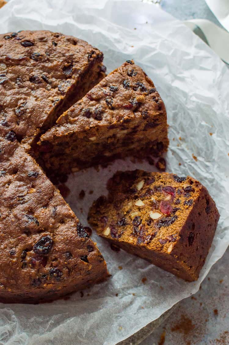 Sliced vegan Christmas fruitcake with dried fruits and almonds.