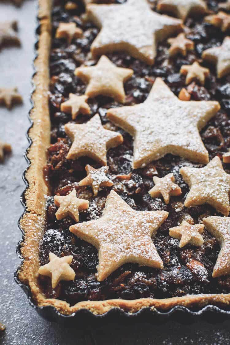 Angled close up of shortbread star topped vegan mince pie tart.