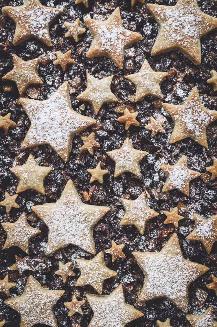 Close up of cinnamon shortbread star topped vegan mince pie tart.