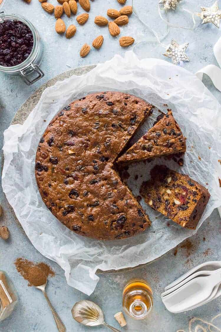 Vegan Christmas cake - a rich, moist and boozy vegan fruit cake that is perfect for the festive season. Eat right away or make in advance and feed regularly with rum or brandy. #vegan #christmas #cake