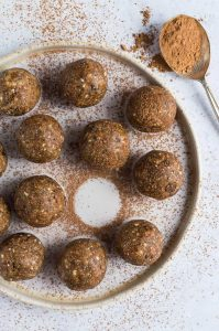 Chocolate chip peanut butter energy bites - these healthy protein packed energy balls taste like chocolate chip peanut butter cookie dough! They take just ten minutes to make and are perfect for snacking on when you need a boost. #vegan #blissballs #energybites