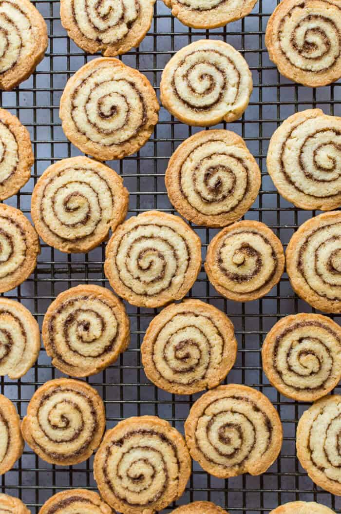 Vegan cinnamon swirl biscuits on a wire cooling rack