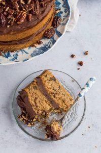 Maple pecan cake with chocolate cashew cream frosting - this lovely vegan cake is naturally sweetened with maple syrup, making it a slightly healthier treat that is still delicious. #vegan #naturallysweetened #vegancake