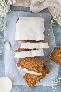 Vegan carrot cake loaf - this is the best vegan carrot cake! Easy to make, moist, sweet and spicy with a zingy lemon glaze; this loaf cake is perfect for snacking on. #vegan #carrotcake #vegancake #veganbaking