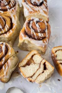Close up of a vegan banana bread cinnamon roll sliced in half.