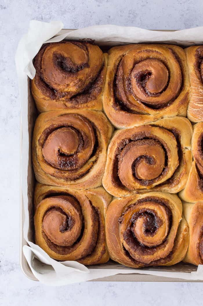 Banana bread cinnamon rolls in a square baking tin.