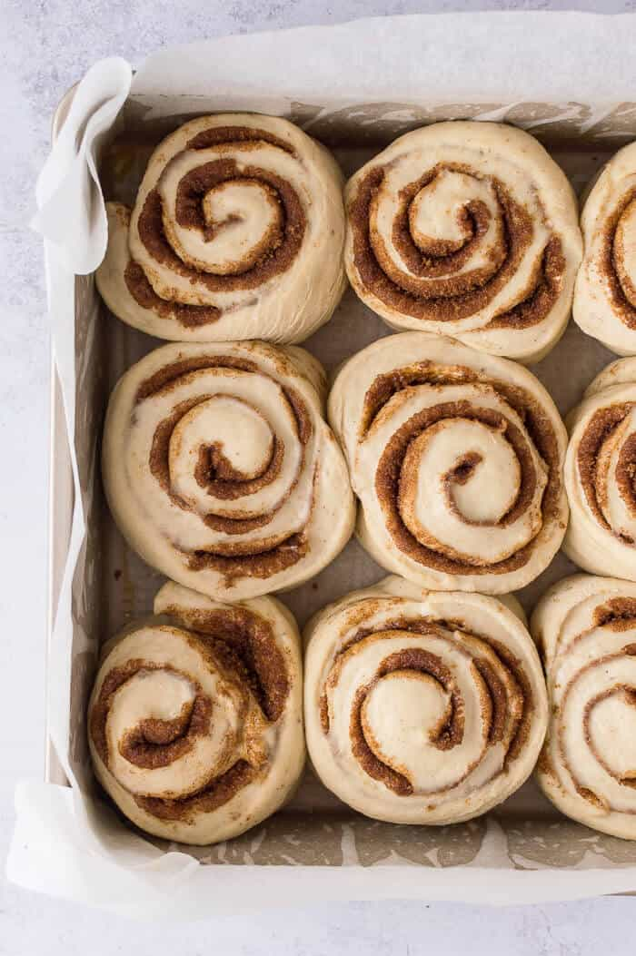 A tray of unbaked vegan banana bread cinnamon rolls