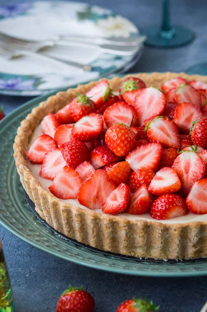 Close up of the side of a vegan strawberry tart to show the pastry.