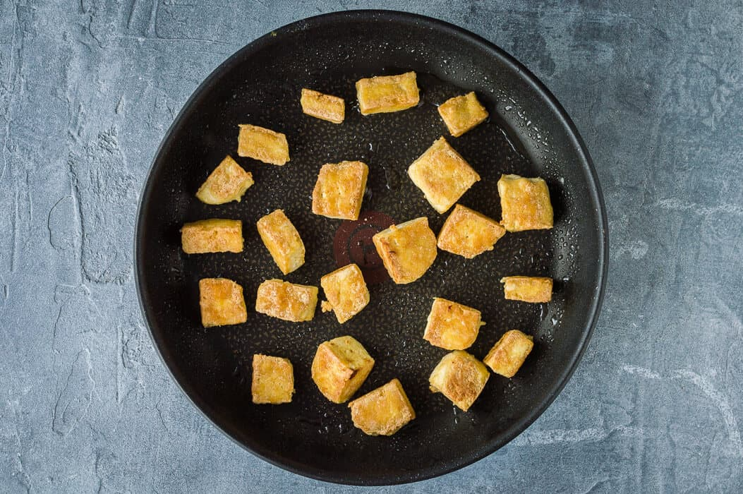 crispy tofu in a pan.