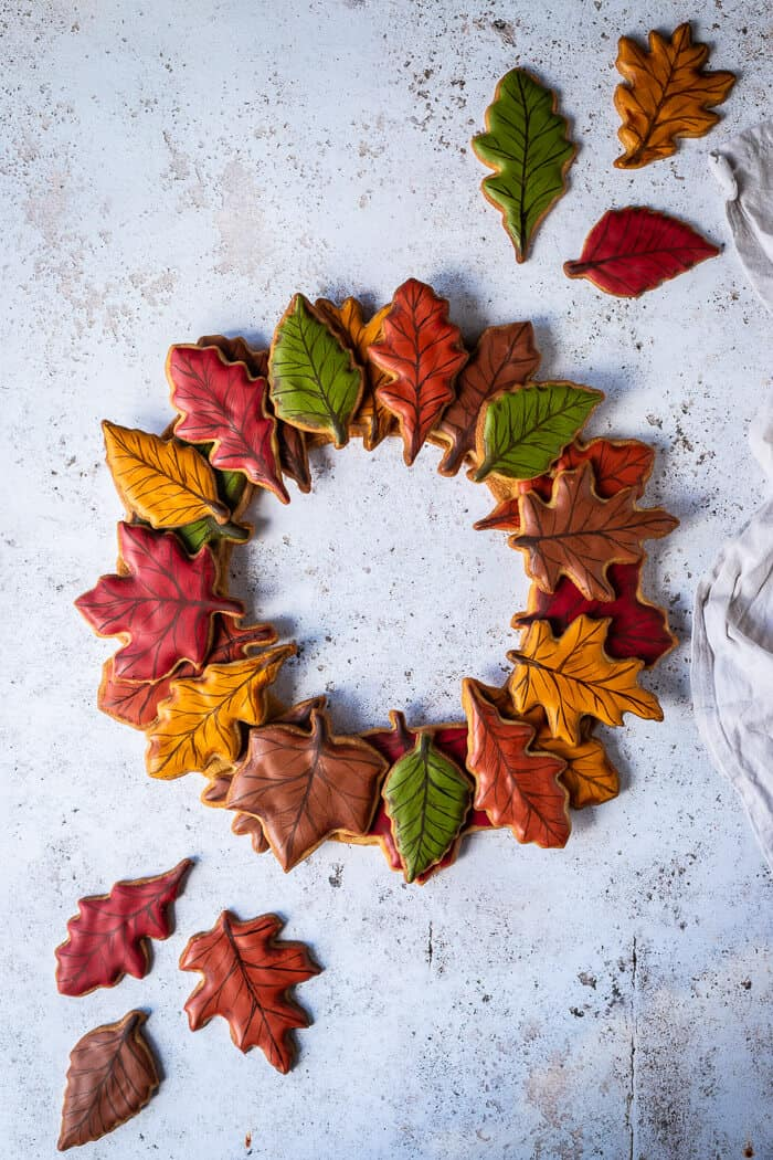 Autumn leaf maple biscuit wreath on a white background with extra leaf cookies.