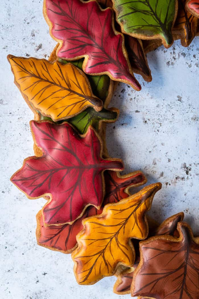 Close up of a red maple leaf cookie on a cookie wreath.