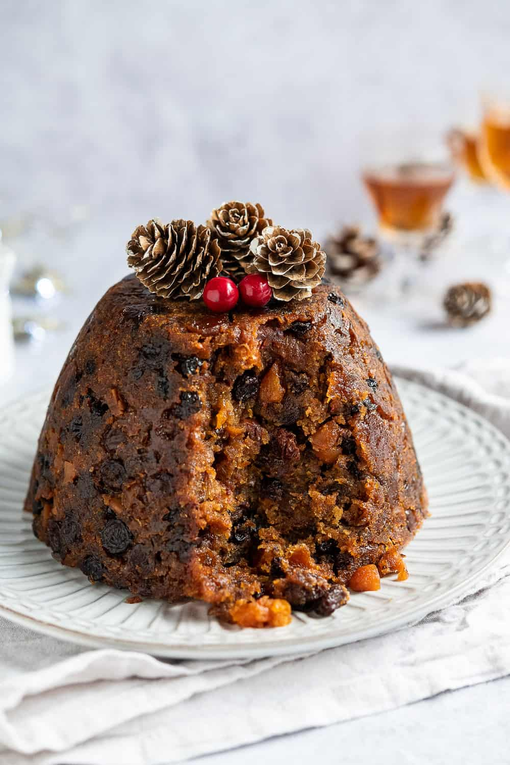 close up of vegan christmas pudding with a spoonful removed.