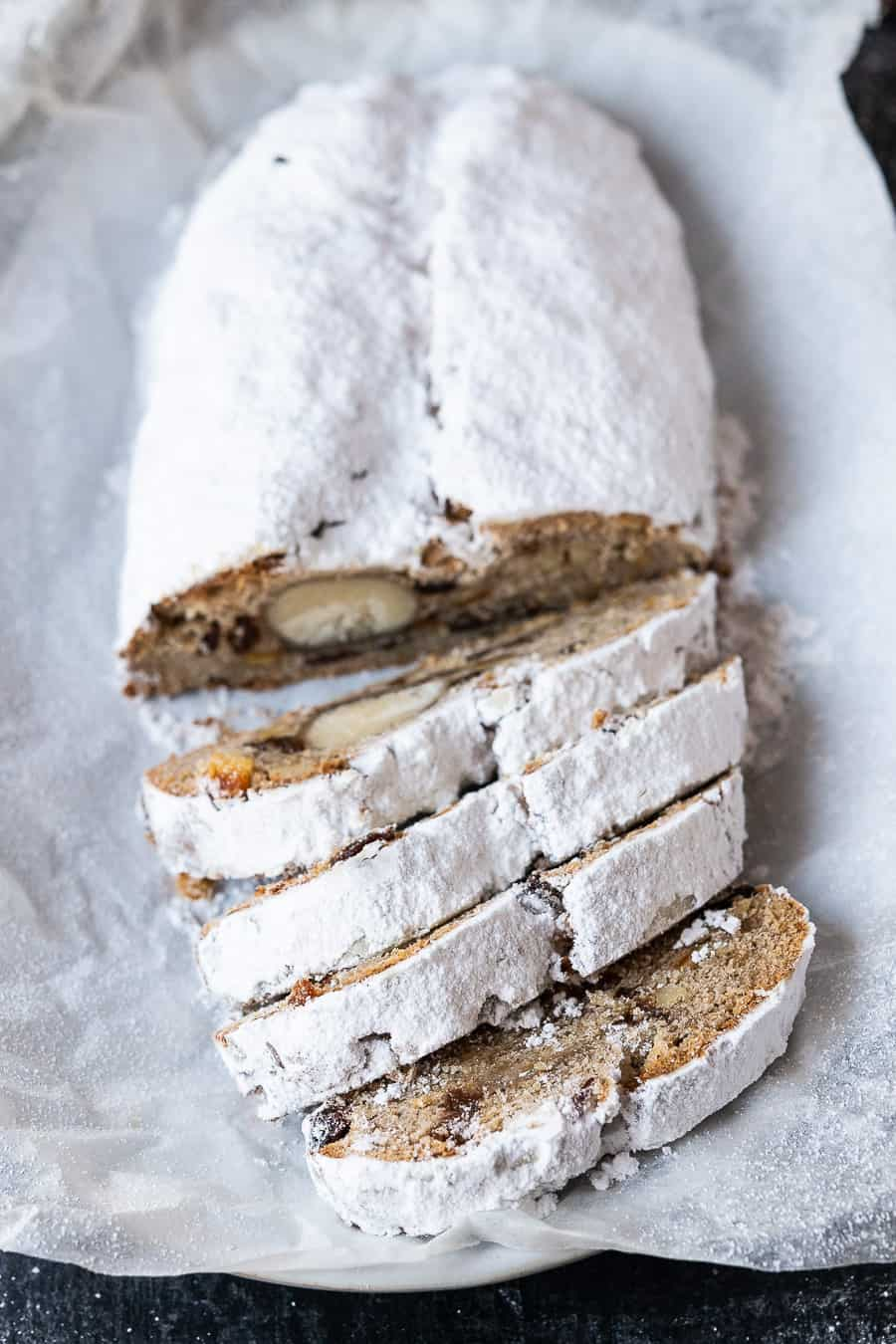 a sliced loaf of icing sugar coated stollen.