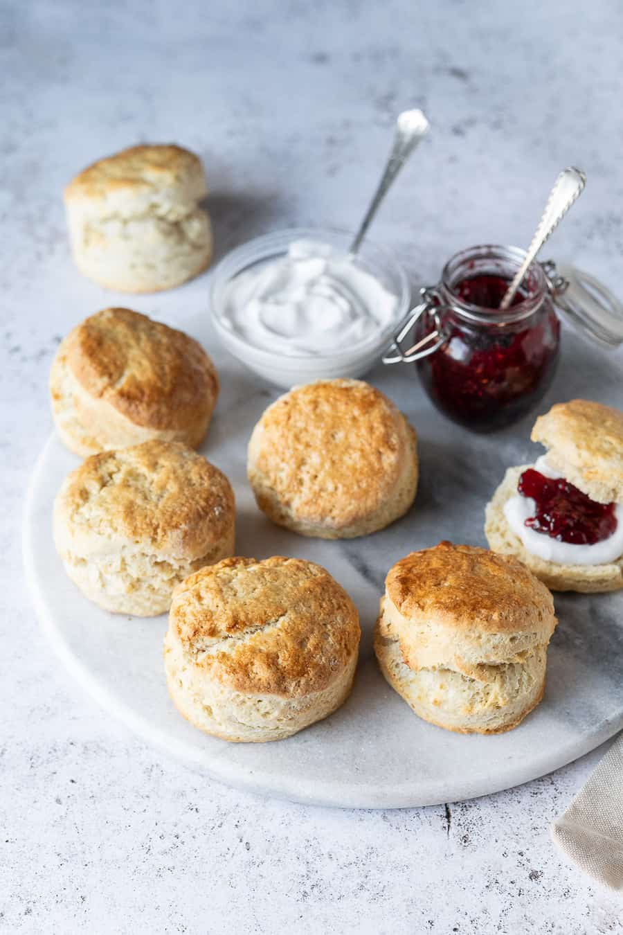 Vegan scones on a marble platter on a white background.