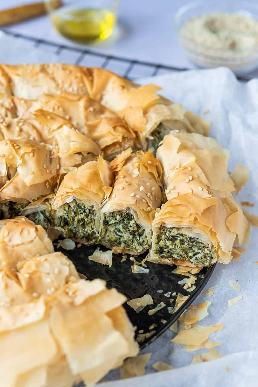 close up of a slice of vegan spinach and feta filo pastry pie.