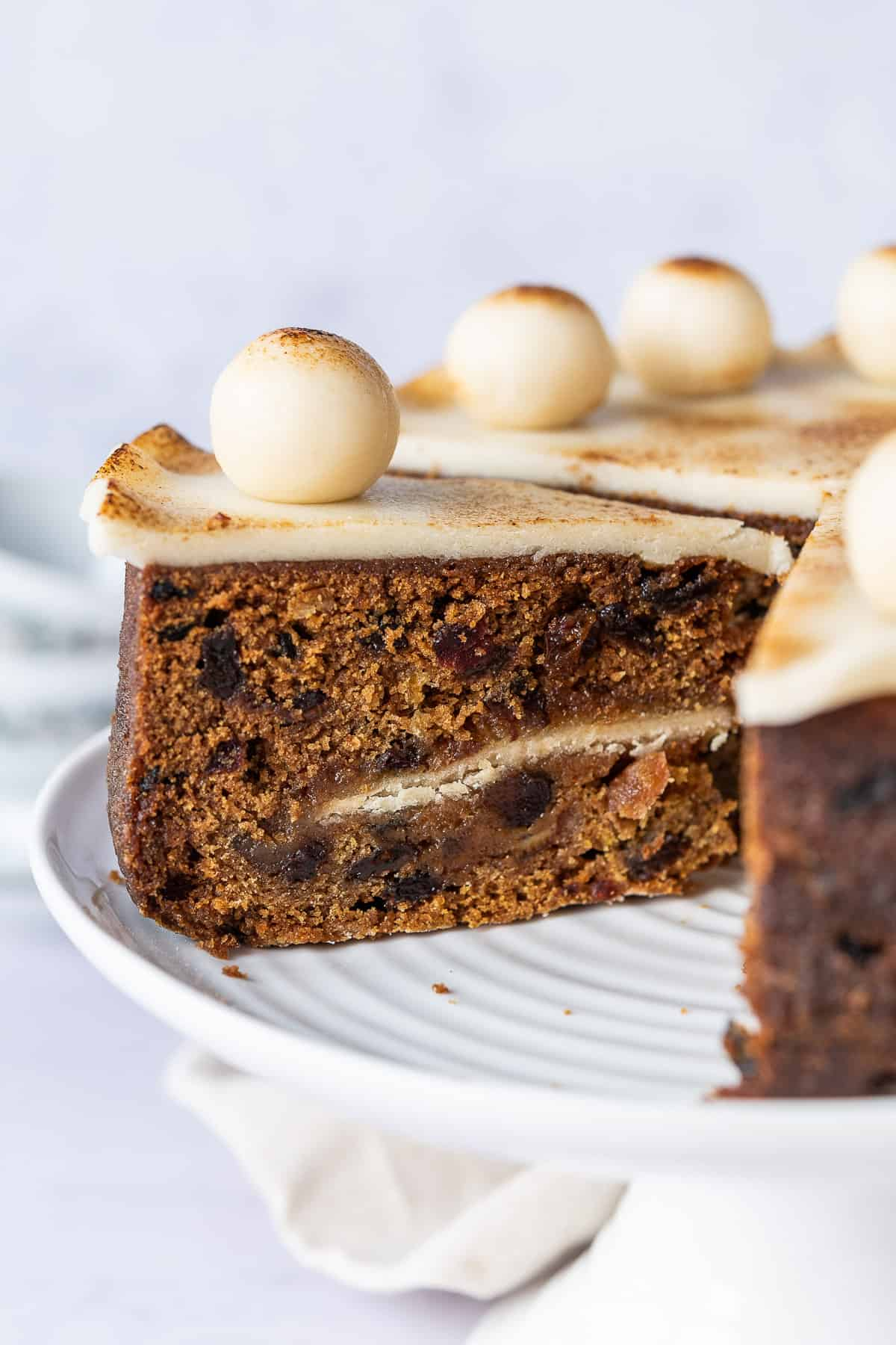 Close up of a slice of vegan simnel cake.