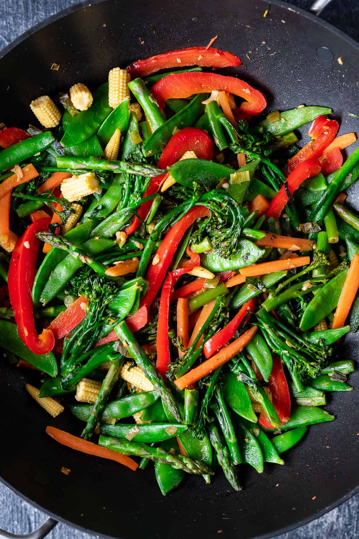 stir fried vegetables in a wok