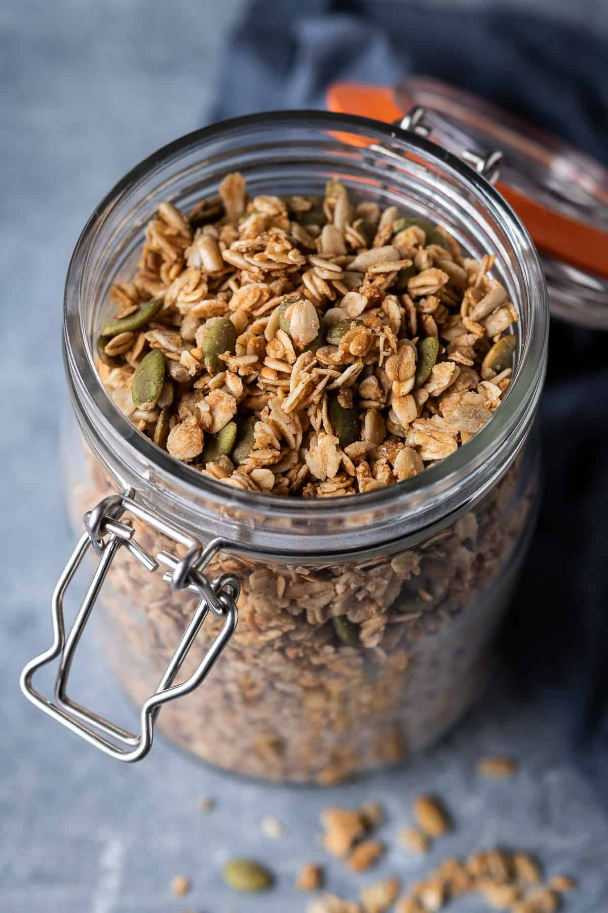 a glass jar full of vegan granola.