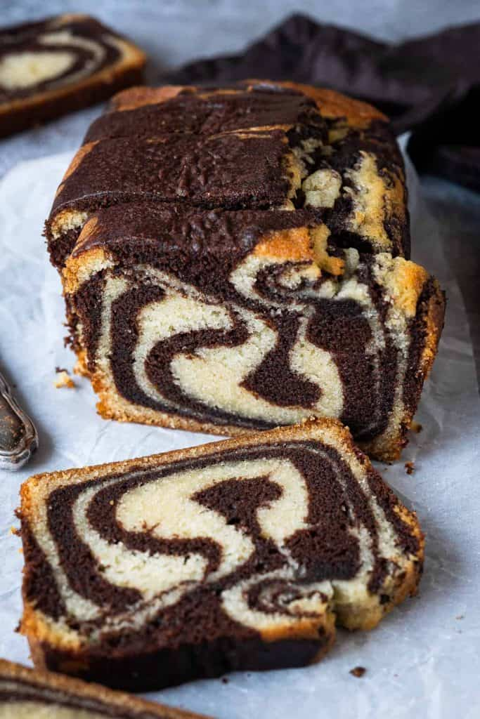 vegan marble cake on a sheet of white baking parchment