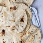Easy flatbreads on a tea towel.