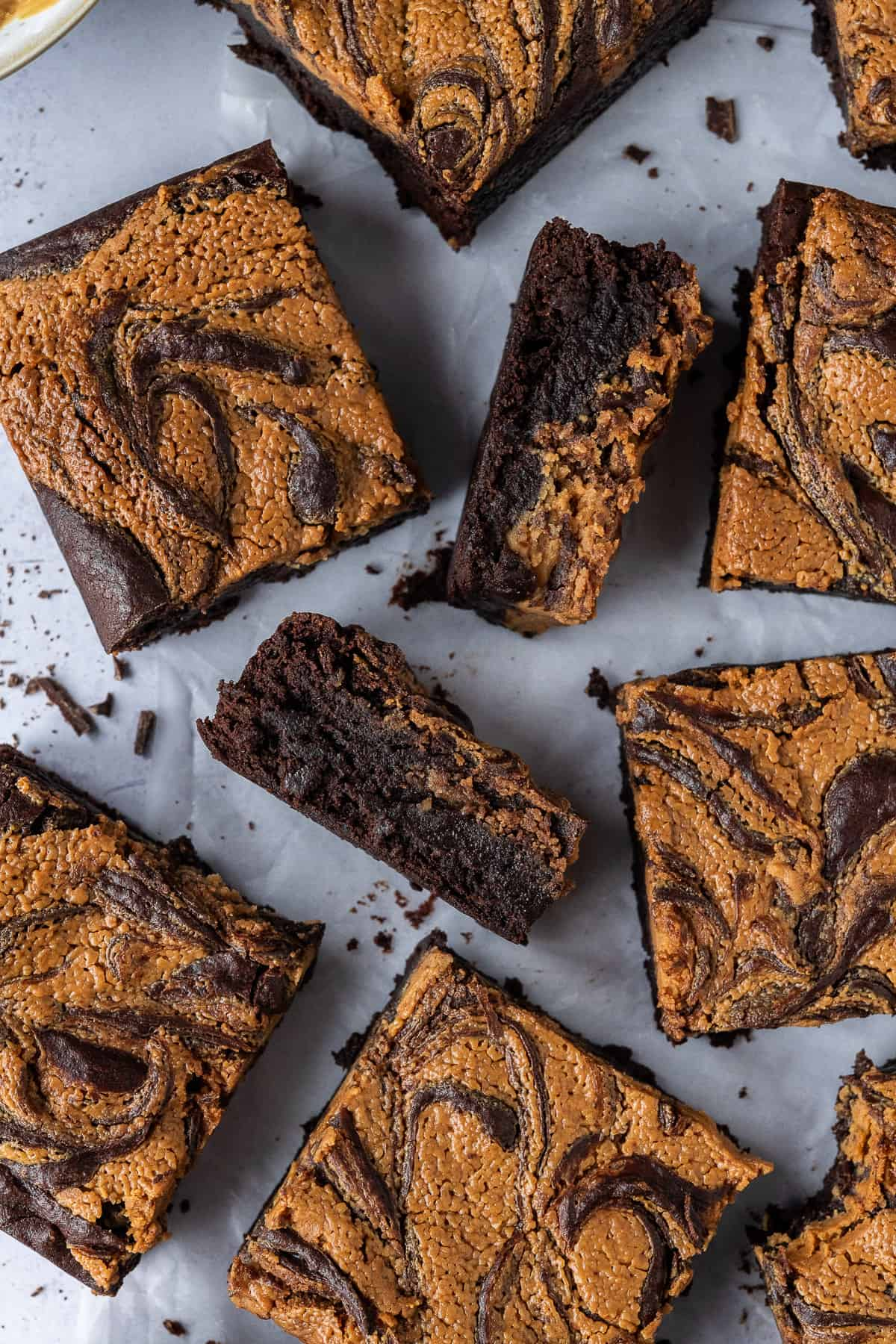Close up of squares of peanut butter swirl brownies.