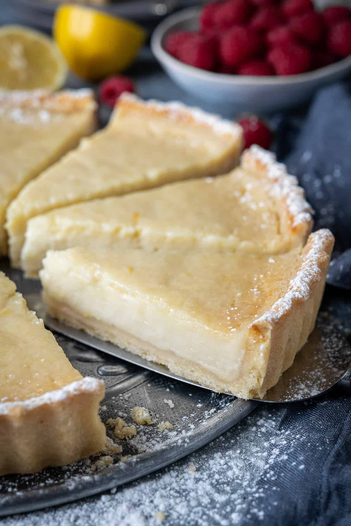Close up of a slice of vegan lemon tart