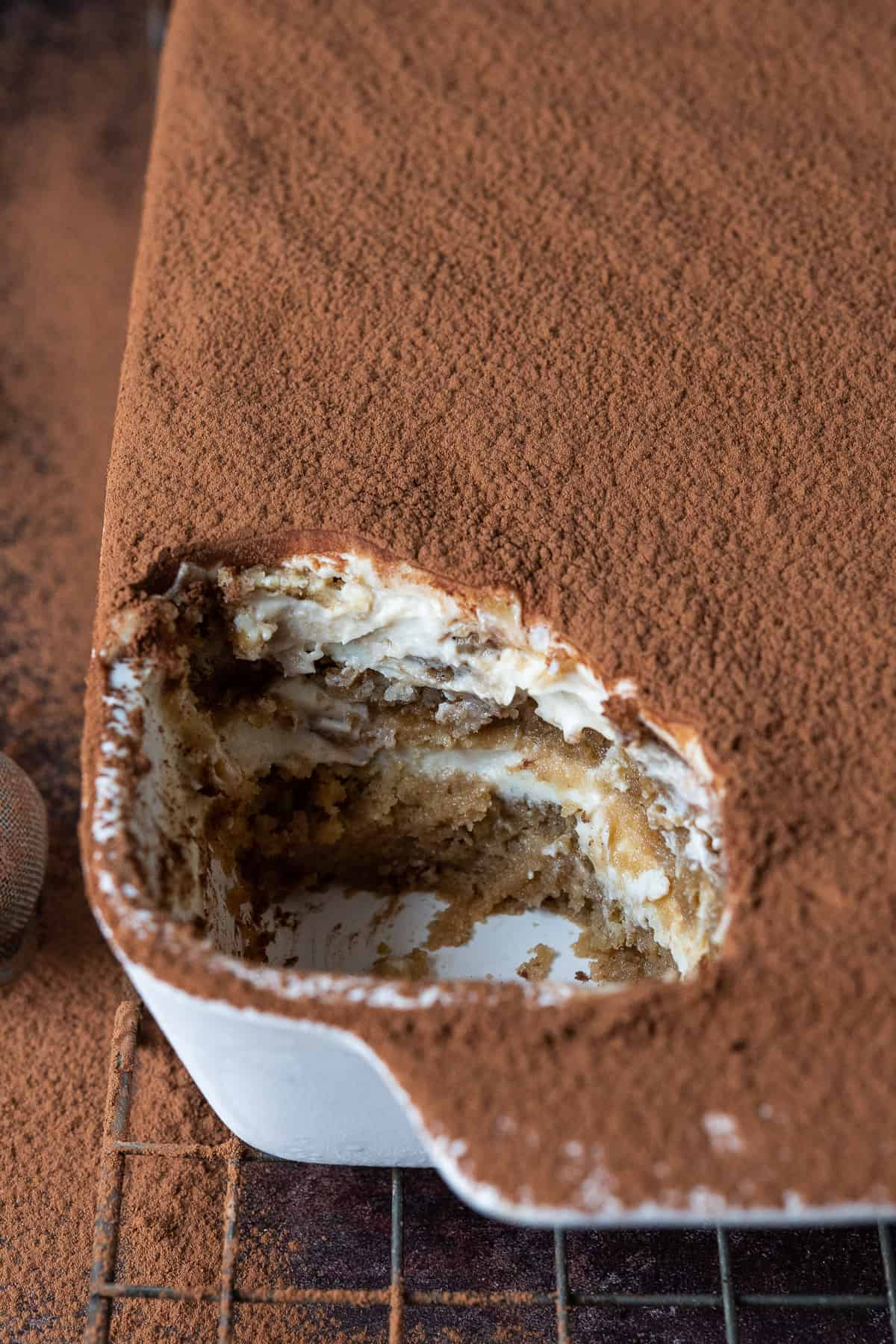 Close up of vegan tiramisu with a spoonful removed.