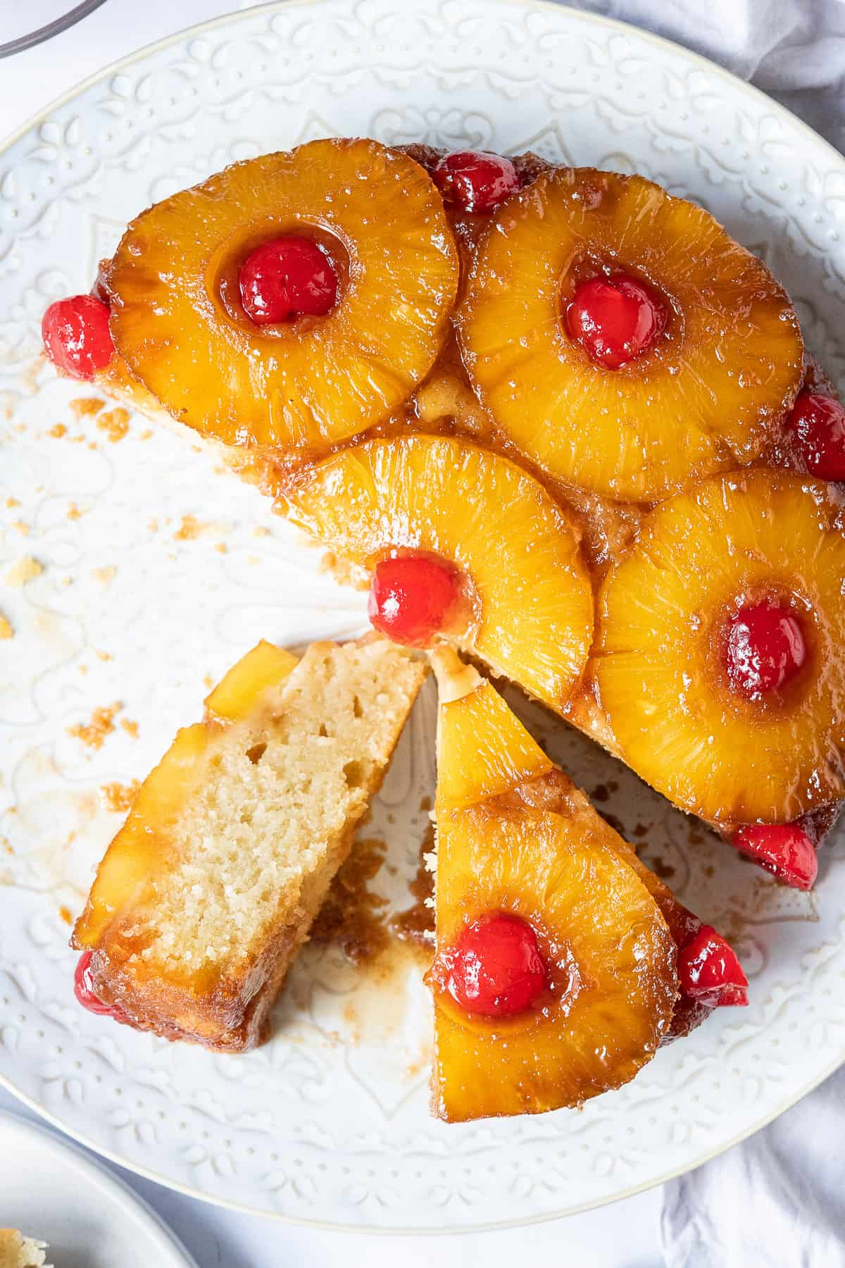 Close up of vegan pineapple upside-down cake, cut into slices.