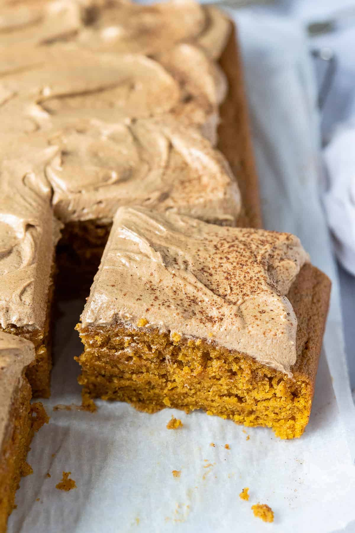Close up of a slice of vegan pumpkin spice latte cake.