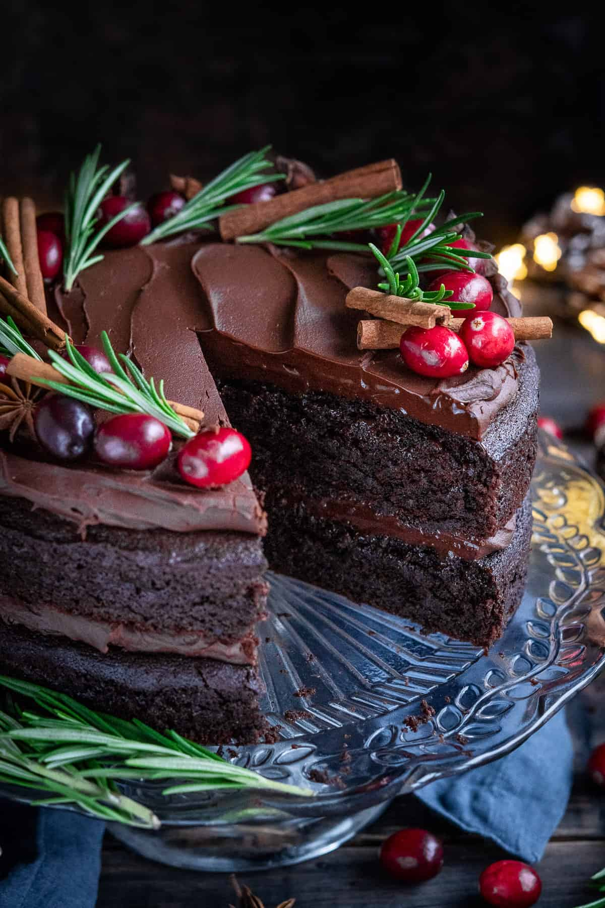 Close up of vegan mulled wine chocolate cake with a slice removed.