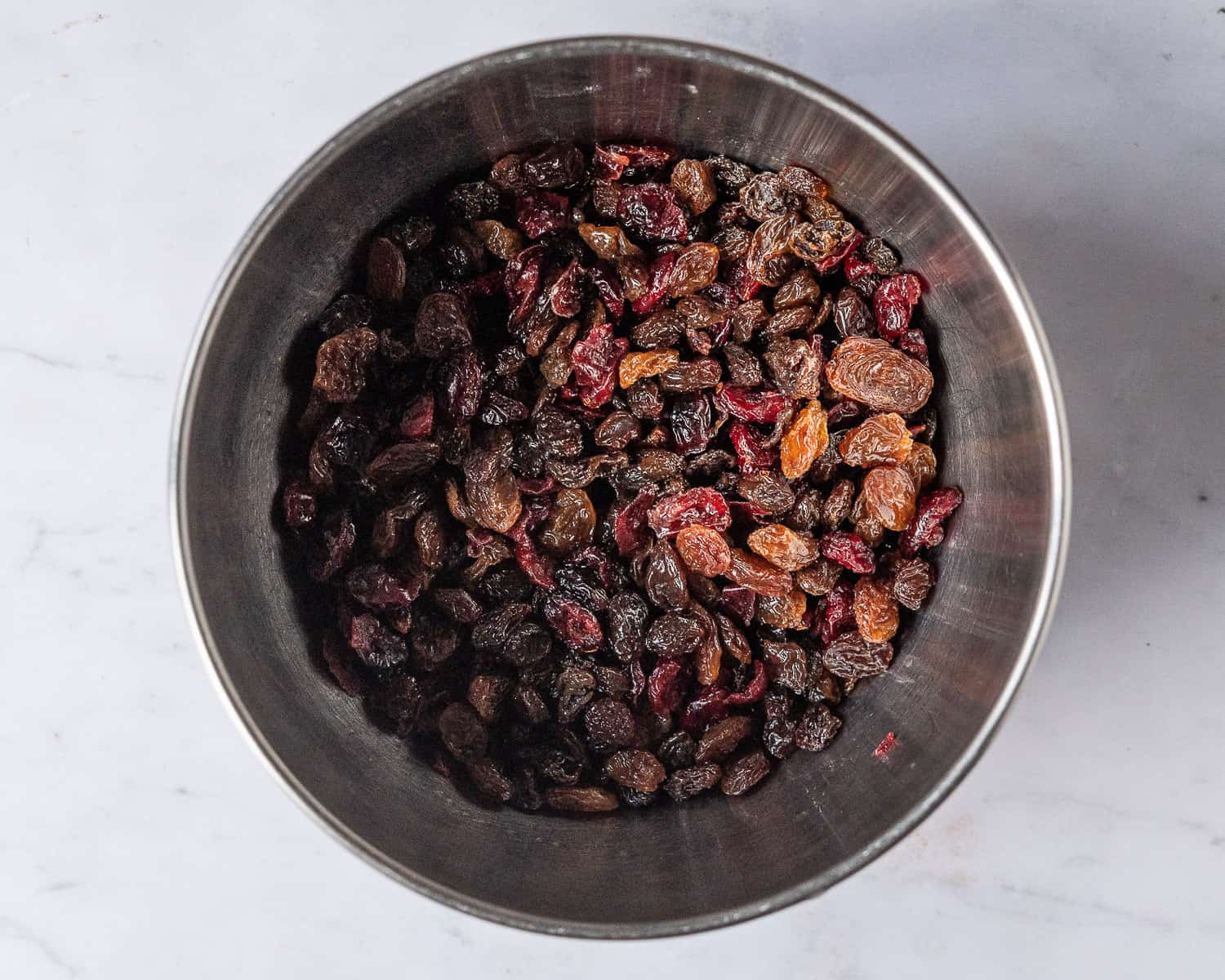 A bowl of soaked dried fruits.