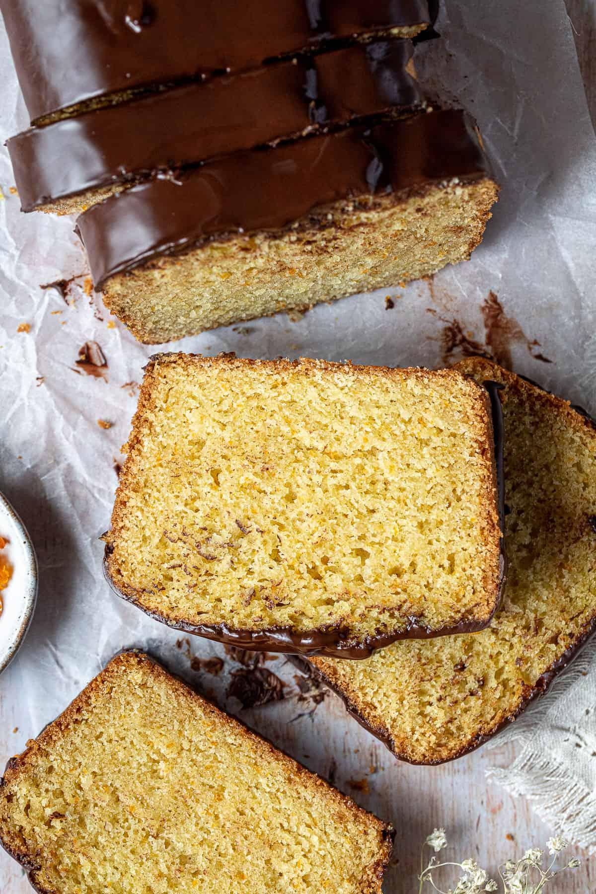 Close up of a slice of vegan orange loaf cake.