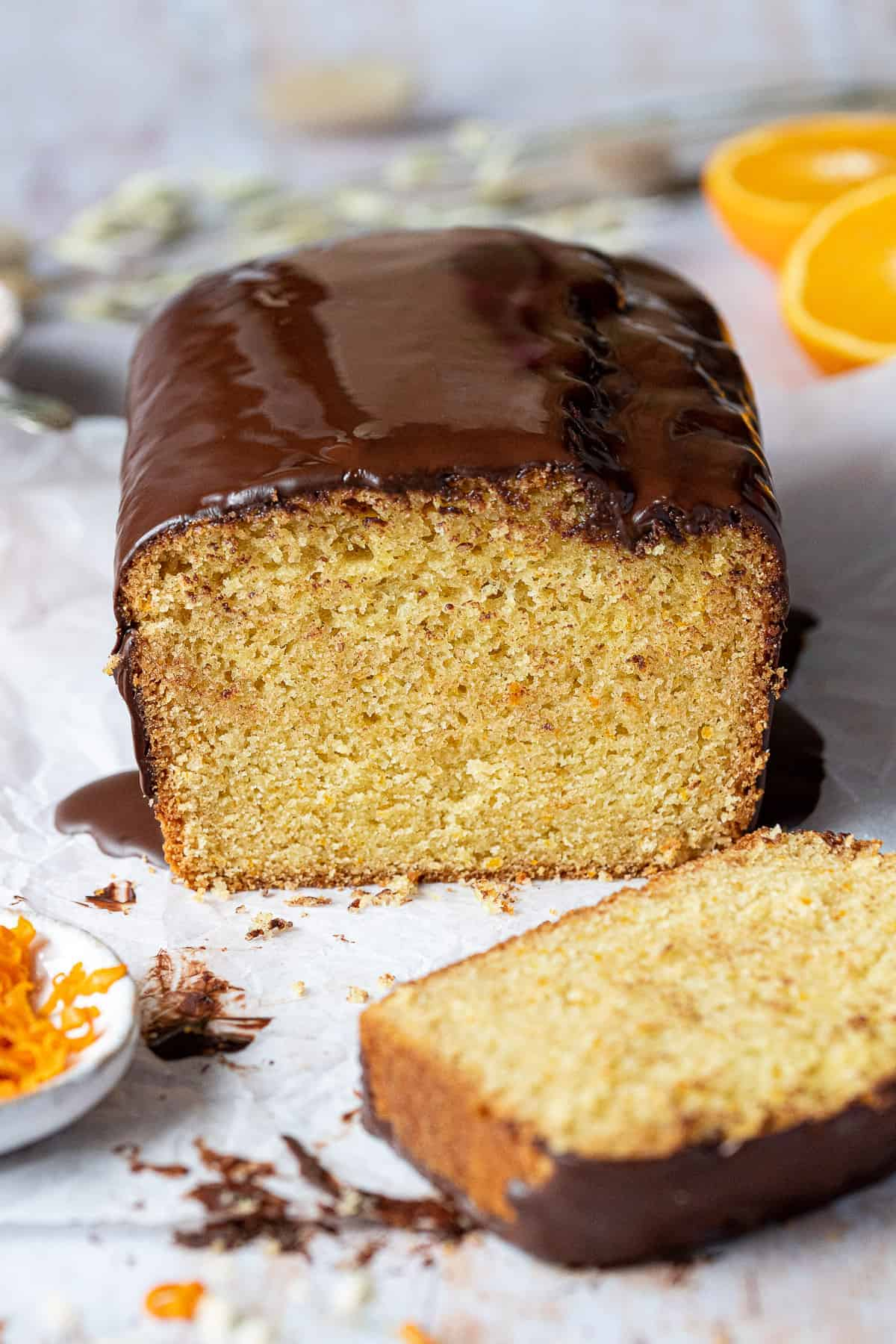 Close up of sliced vegan orange loaf cake.