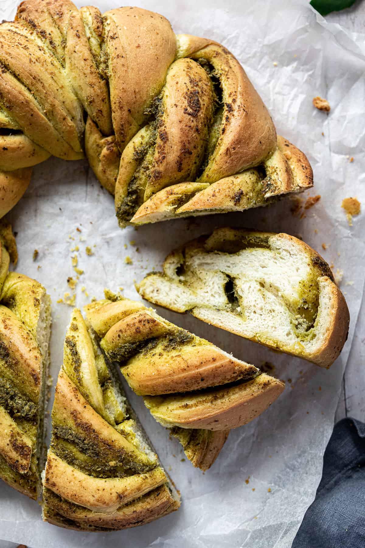 Close up of slices of vegan pesto bread.