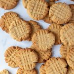 Vegan peanut butter cookies on a marble surface.