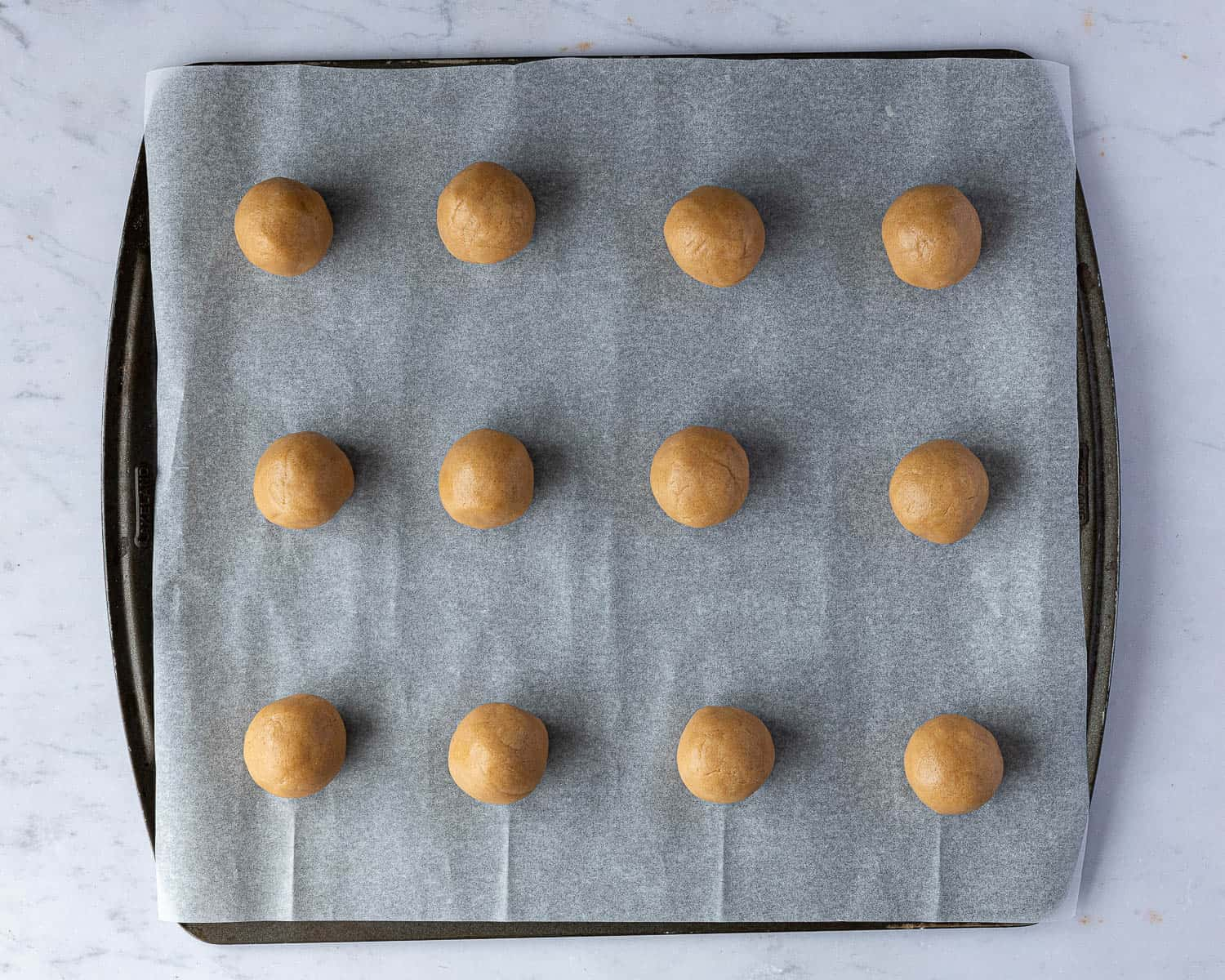 Step 3 - the cookie dough balls on a baking sheet.